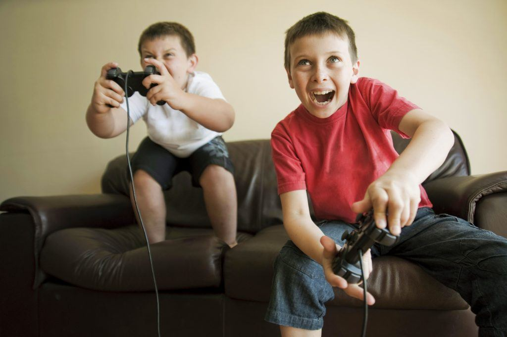 Kids playing video game 97577269