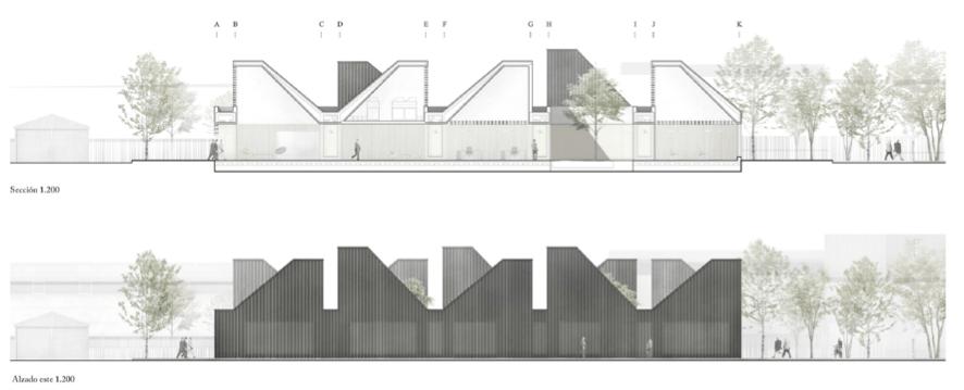 Alzado del edificio con sección industrial y cubierta de sierra