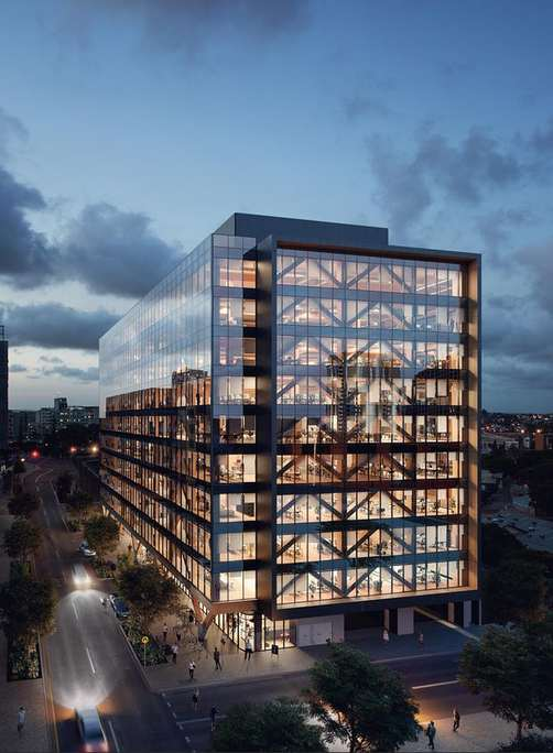 Render de las oficinas cone structura de madera y muro cortina de vidrio de noche