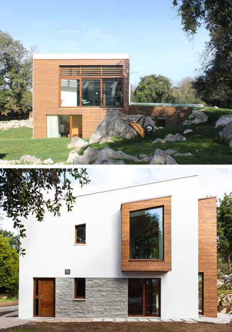 Vista exterior de madera y pintura blanca con cubeirta inclinada en un plano